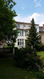 besonderes Mehrfamilienhaus mit historischen Details und großzügigem Grundstück