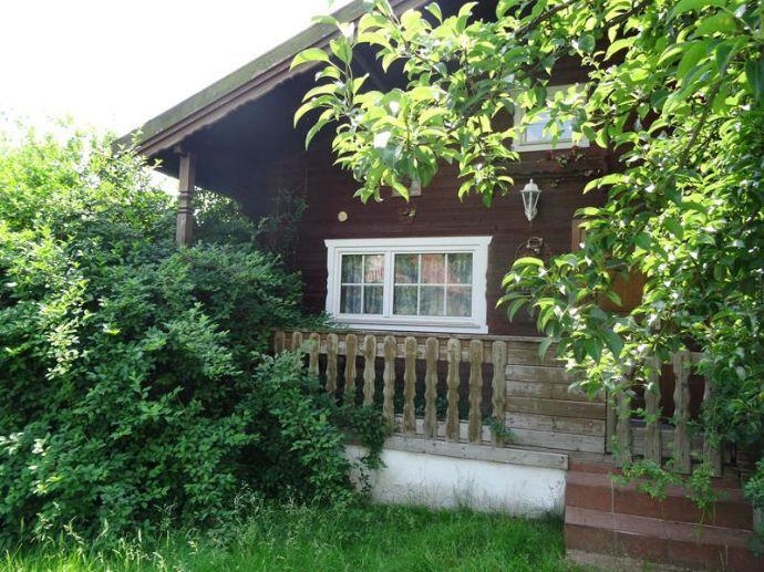 Grundstück bebaut mit einem Ferienhaus in sehr gute Lage zu verkaufen